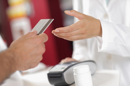 Buying with Credit Card in the Pharmacy. photo