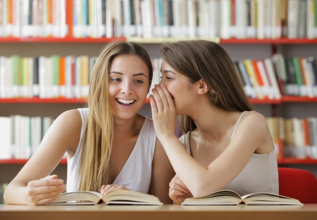 tells: Young student tells to the girlfriend good news Stock Photo