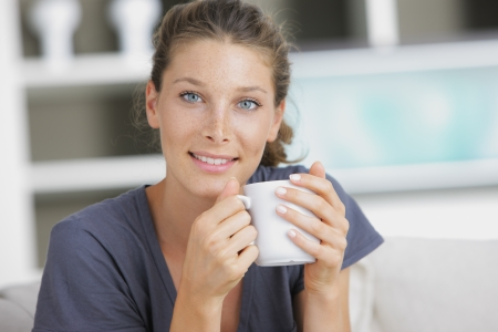 Portrait of a beautiful young lady with cup photo