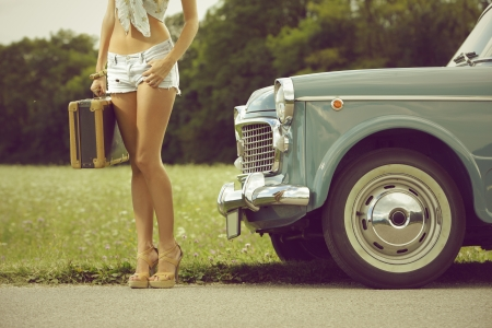 sexy legs: Young sexy girl with suitcase and vintage cars