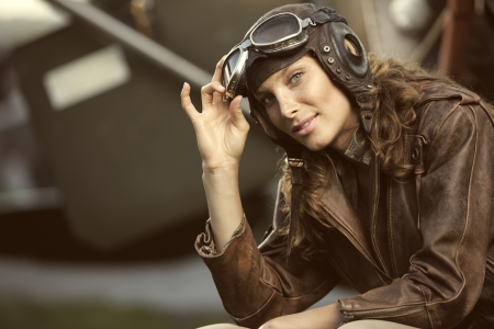 Portrait of young woman airplane pilot. Fashion model photo