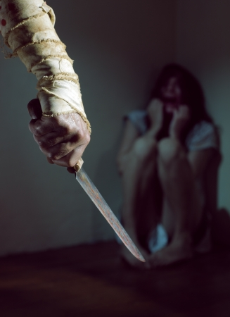 Scared woman threatened by a man with bloody knife