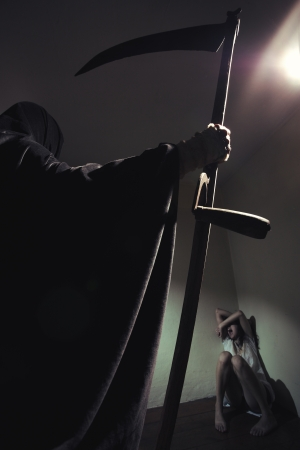 terror: Grim reaper menace a young woman scared
