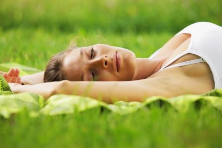 Beautiful woman sleeping on the grass  photo