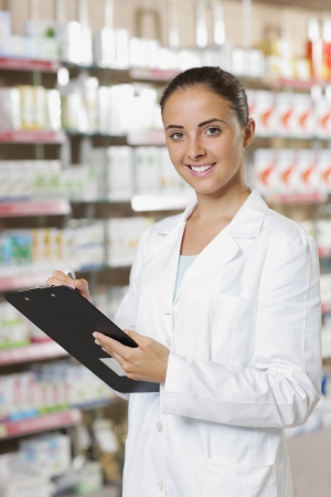 pharmacist: Environmental Portrait of a medical personnel, or doctor in pharmacy