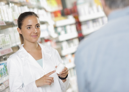 pharmacist: Senior man talking with woman pharmacist Stock Photo