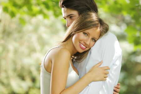 the romantic embrace of a young couple in love photo