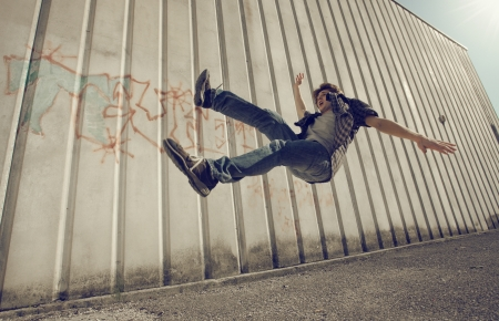 falling down: Young man falling from a building Stock Photo