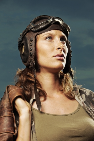 Portrait of young woman aviator photo