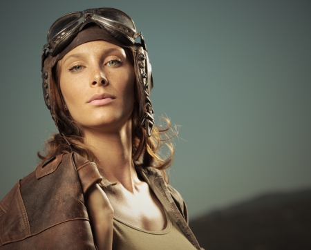 Portrait of young woman airplane pilot photo