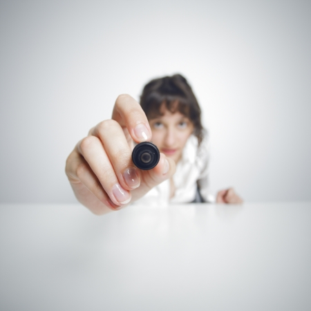 focused Businesswoman with pen Stock Photo - 15517660