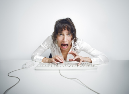 Funny and quite grotesque frontal portrait of a scared woman at her office desk Stock Photo - 15517664