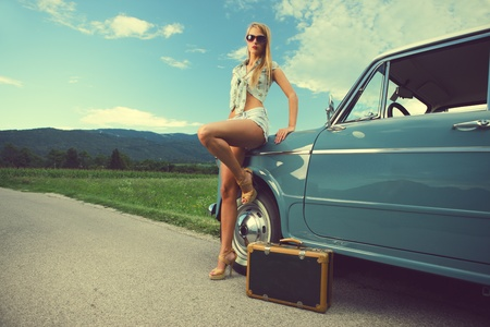 Fashion model with vintage cars, summer travel photo