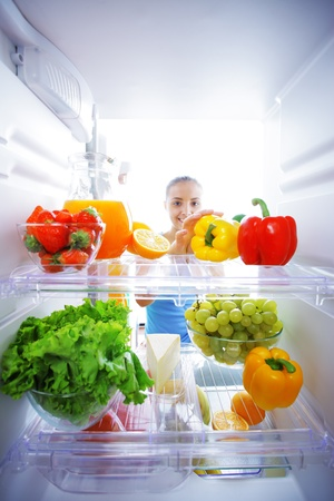 Woman reaching for food in refrigerator, view from inside Stock Photo - 15472558