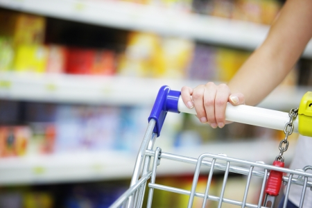 grocery shopping: Woman with shopping cart, close up Stock Photo