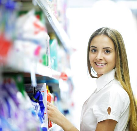 Smiling woman in a Grocery Store Stock Photo