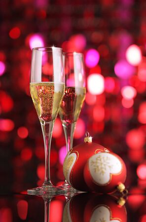 new year  s day: Glasses of champagne with Christmas decorations