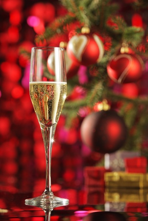 new year  s day: Glass of champagne with Christmas decorations