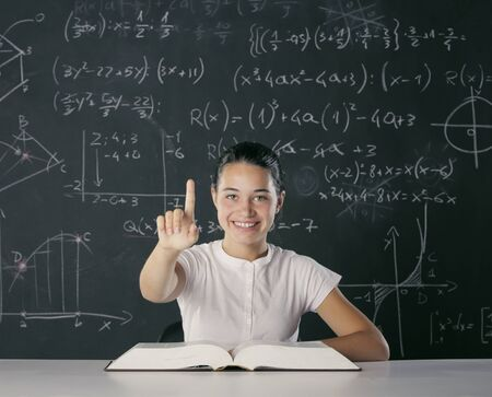 solves: Smart girl solves a difficult mathematical task Stock Photo