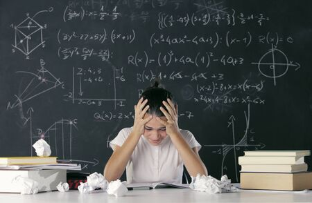 Girl fails to solve a mathematical task photo