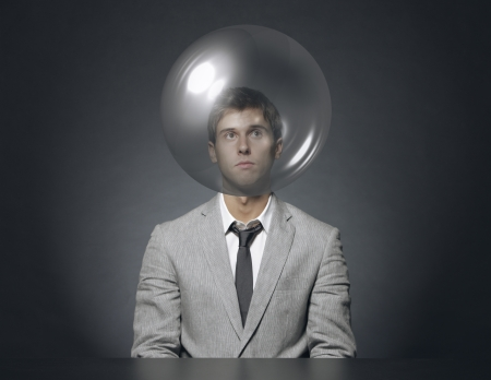 young businessman with head in a transparent bubble Stock Photo - 15783297