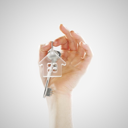 house keys: Hand of a young man holding house keys
