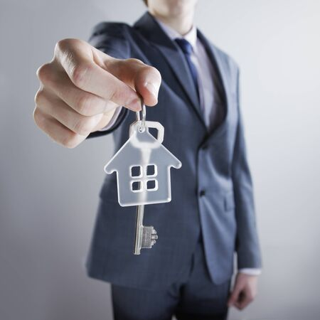 house keys: Young businessman giving house keys