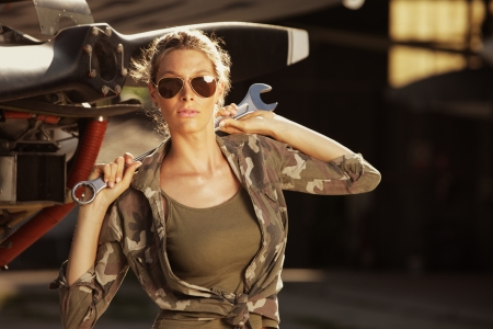 airplane engine: Woman airplane mechanic. Airplane on the background