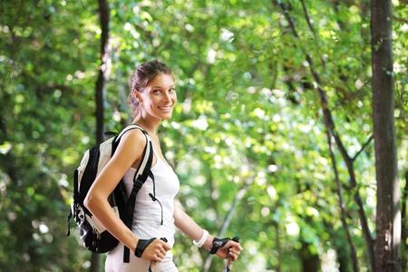 nordic walking: Woman walking cross country in forest