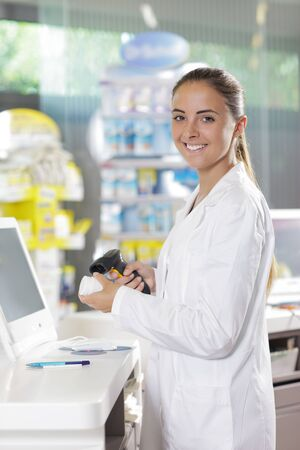 bar code: Portrait of a smiling female pharmacist at pharmacy