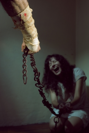 woman prison: Chained slave woman,  prisoner of an evil man