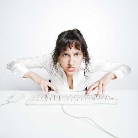 angry computer: Female secretary crazed from overwork Stock Photo