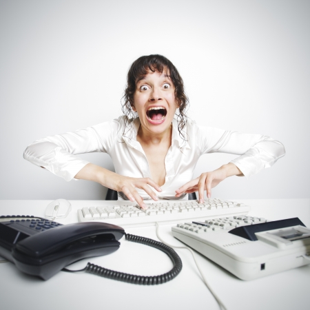 Female secretary crazed from overwork Stock Photo - 16141298