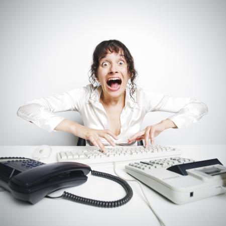despair: Female secretary crazed from overwork Stock Photo