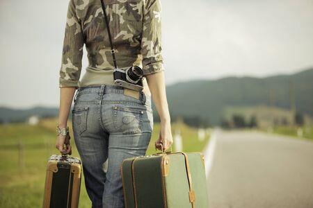 Young woman runaway walks away road. Copy space Stock Photo - 16141143