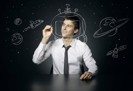 Young man dreams of space travel Stock Photo - 16141203