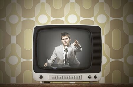 Old TV screen on vintage background,. Anchorman smiling on screen photo