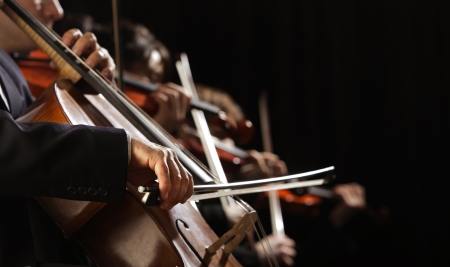 Symphony concert, a man playing the cello, hand close up Stock Photo