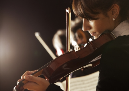 orchestra: Violinist woman playing a concert of classical music