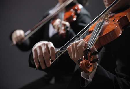 violin: Symphony music, violinist at concert, hand close up