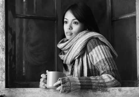 Portrait of a beautiful woman  with a cup of coffee or tea photo