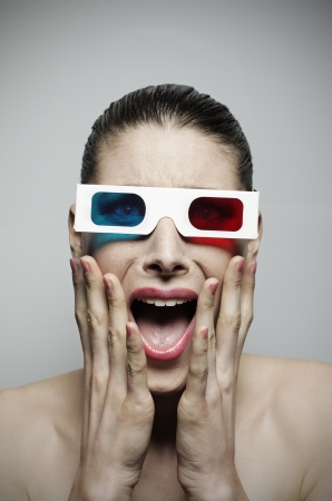Scared woman watching a horror 3d movie