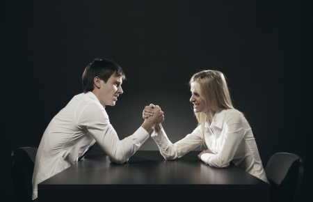 arm in arm: husband and wife Arm Wrestling Stock Photo