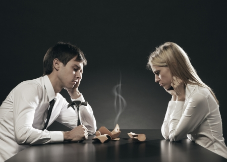 Portrait of young couple unhappy about their savings  Stock Photo - 16661639