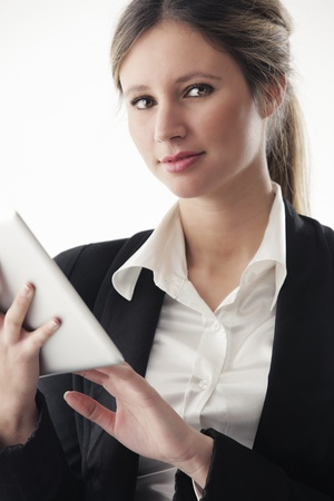 Portrait of young business woman working on digital tablet photo