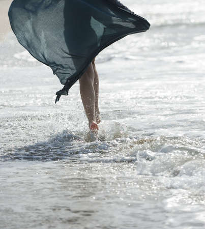 A young woman walking on the water Stock Photo - 16675956