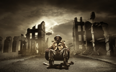 earthquake: Post apocalyptic survivor in gas mask, destroyed city in the background Stock Photo