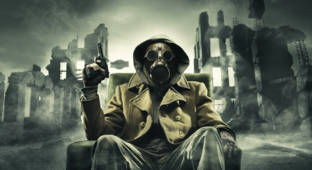 rubble: Post apocalyptic survivor in gas mask, destroyed city in the background Stock Photo