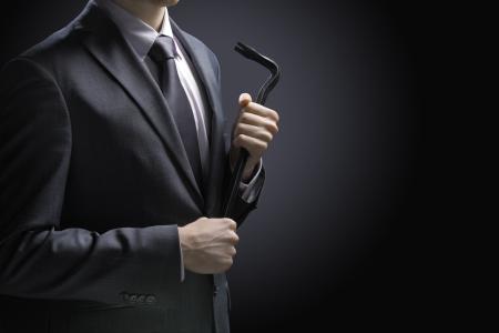 Businessman burglar with crowbar on black background Stock Photo - 17070686