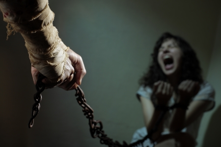 domestic violence: Chained slave woman,  prisoner of an evil man